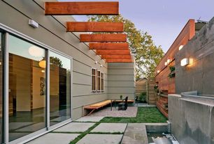 Contemporary Patio with Pathway, Casement, exterior stone floors, sliding glass door, Trellis, Pond