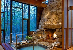 Rustic Hot Tub with Interior & exterior connection, Stacked stone fireplace, French doors, Pool with hot tub