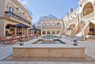 Mediterranean Swimming Pool with Transom window, Pathway, Deck Railing, Arched window, exterior stone floors, French doors