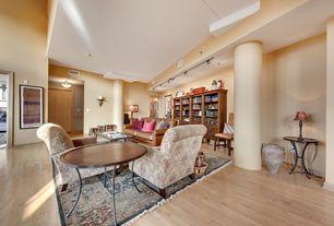 Traditional Living Room with Hardwood floors, Standard height, Columns, flush light