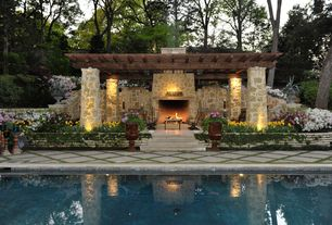 Traditional Patio with stone fireplace, exterior stone floors, Lap pool, Raised beds, Pathway, Trellis, Pergola