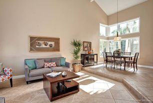 Modern Great Room with Casement, Sunken living room, Concrete tile , Pendant light, High ceiling