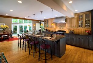 Eclectic Kitchen with Glass panel, Flat panel cabinets, Stone Tile, Design within reach, Transom window, Breakfast bar