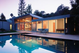 Contemporary Swimming Pool with exterior tile floors, Transom window, Pathway