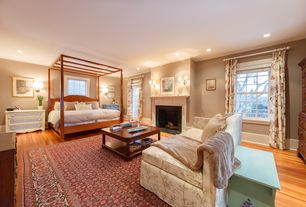 Traditional Master Bedroom with Wall sconce, Built-in bookshelf, French doors, stone fireplace, Hardwood floors