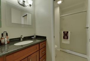 Traditional 3/4 Bathroom with can lights, limestone floors, Built-in bookshelf, Wall sconce, Standard height