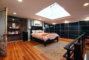 Contemporary Master Bedroom with interior brick, Built-in bookshelf, Skylight, Glass panel door, Hardwood floors