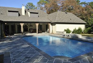Traditional Swimming Pool with French doors, Fence, exterior stone floors, Pathway, Fountain, Lap pool