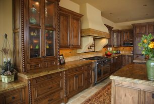 Mediterranean Kitchen with slate tile floors, L-shaped, Raised panel, Complex granite counters, Travertine Tile, Stone Tile