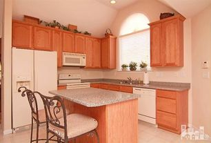 Traditional Kitchen with Undermount sink, Simple Granite, Kitchen island, limestone tile floors, Simple granite counters