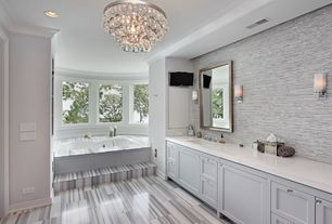 Traditional Master Bathroom with World stone gallerymarmara white, Corian counters, Built-in bookshelf, Crown molding, Flush
