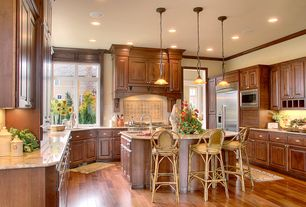 Traditional Kitchen with Complex granite counters, U-shaped, Stone Tile, Kitchen island, Undermount sink, Breakfast bar