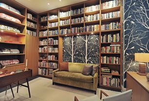 Contemporary Home Office with Built-in bookshelf, Hardwood floors, interior wallpaper