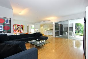 Contemporary Great Room with Hardwood floors, Wall sconce, High ceiling