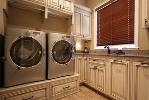 Traditional Laundry Room with Crown molding, Delta Linden Single-Handle Kitchen Faucet, Built-in bookshelf, Wall sconce