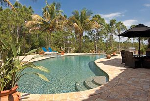 Tropical Swimming Pool with Pool with hot tub, exterior stone floors, Outdoor kitchen