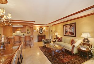 Traditional Living Room with herringbone tile floors, Crown molding, Wall sconce
