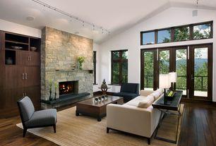 Contemporary Living Room with French doors, stone fireplace, Engineered hardwood flooring, Track lighting, Hardwood floors
