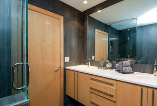 Contemporary Master Bathroom with Corian counters, frameless showerdoor, Pental - Corten Porcelain Tile Collection, Flush