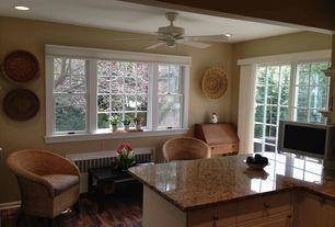 room with Ceiling fan, Hardwood floors, Built-in bookshelf