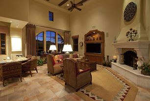 Mediterranean Living Room with double-hung window, Ceiling fan, Exposed beam, High ceiling, can lights, Arched window