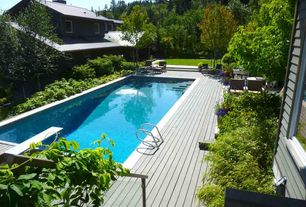 Contemporary Swimming Pool with Casement, Outdoor kitchen, Lap pool, Pathway, Deck Railing