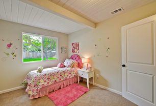 Traditional Kids Bedroom with specialty door, Standard height, Casement, Carpet, Exposed beam