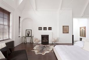 Modern Master Bedroom with Sawhorse writing desk, Swan chair, Zebra printed cow hide rug