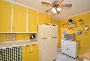 Cottage Kitchen with flush light, European Cabinets, large ceramic tile floors, Paint 1, Built In Refrigerator, Crown molding
