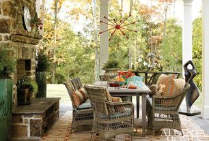 Rustic Porch with exterior stone floors, outdoor pizza oven
