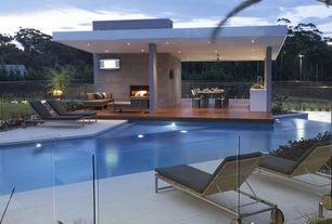 Contemporary Swimming Pool with outdoor pizza oven, Outdoor kitchen, Raised beds, exterior stone floors, Fence