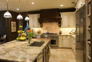 Traditional Kitchen with Limestone Tile, Autumn / french pattern, Undermount sink, Pendant light, Raised panel, Custom hood