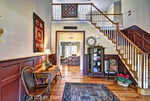 Country Entryway with Hardwood floors, Loft, Wainscotting, Cathedral ceiling