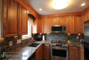 Traditional Kitchen with flush light, Ceramic Tile, U-shaped, Simple granite counters, Raised panel, Glass counters