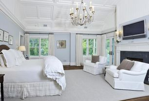 Traditional Master Bedroom with Casement, Wall sconce, Standard height, Fireplace, French doors, Box ceiling, Crown molding