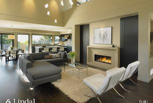 Contemporary Living Room with can lights, specialty door, Columns, Loft, insert fireplace, High ceiling, Chandelier