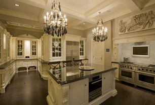 Traditional Kitchen with Centaur granite countertops black galaxy, Built In Refrigerator, Glass panel, full backsplash