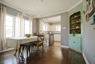 Traditional Dining Room with Crown molding, Hardwood floors, Chandelier, Built-in bookshelf
