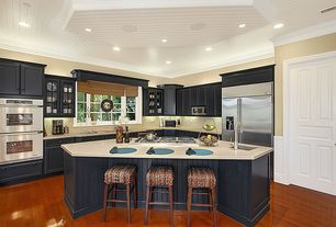 Country Kitchen with specialty door, Undermount sink, dishwasher, Breakfast bar, double wall oven, Casement, electric cooktop