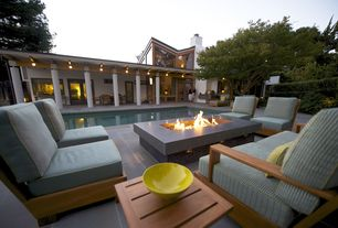 Contemporary Patio with exterior concrete tile floors, Fence, Lap pool, picture window, French doors, exterior tile floors