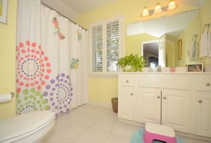 Traditional Kids Bathroom with Kids bathroom, Limestone, limestone tile floors, specialty door, Limestone counters