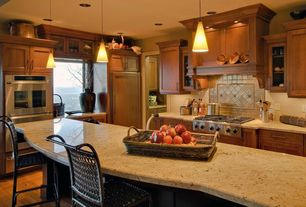 Traditional Kitchen with Standard height, Kitchen island, double wall oven, electric cooktop, Flat panel cabinets, Flush