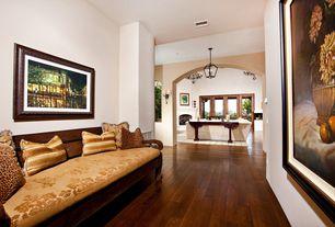 Mediterranean Hallway with can lights, flush light, Hardwood floors, Standard height