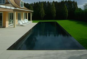 Traditional Swimming Pool with Lap pool, Paint, exterior concrete tile floors, exterior tile floors, Private backyard