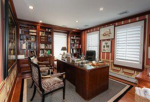 Craftsman Home Office with interior wallpaper, Crown molding, Wainscotting, Hardwood floors, Built-in bookshelf