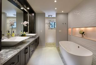 Contemporary Master Bathroom with Master bathroom, Freestanding, Complex marble counters, Ceramic Tile, Vessel sink, Flush
