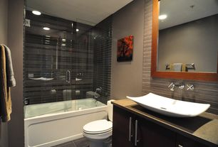 Contemporary Full Bathroom with Vessel sink, Sandstone counters, European Cabinets, tiled wall showerbath, Flush
