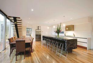 Eclectic Great Room with can lights, flat door, Built-in bookshelf, Pendant light, Hardwood floors, Standard height, Casement