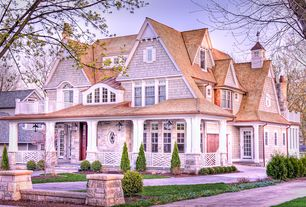 Traditional Exterior of Home with Fence, exterior tile floors, Pathway, French doors