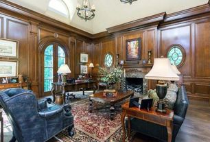 Traditional Great Room with Crown molding, stone fireplace, Chandelier, Chair rail, French doors, Hardwood floors